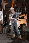 foto of heavy equipment operator  - Young construction worker and forklift operator  on site - JPG