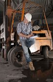 stock photo of heavy equipment operator  - Young construction worker and forklift operator  on site - JPG