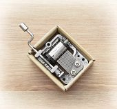 picture of gizmo  - Little music box on a wooden background - JPG