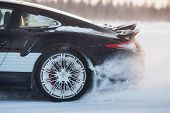LEVI, FINLAND - FEB 20: Rear wheel spin of a PORSCHE 911 TURBO car during Porsche Driving Experience