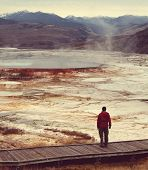 pic of mammoth  - man on Mammoth Hot Spring - JPG