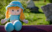 pic of hughes  - Beautiful doll sitting on a bench in sunlight - JPG