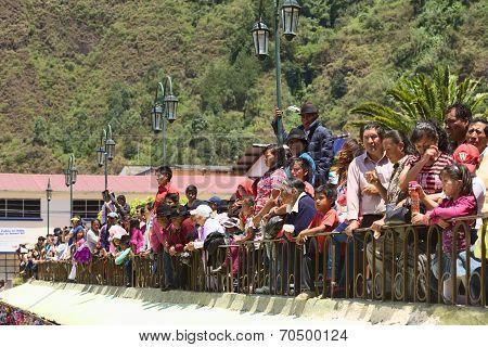 Spectators at the Carnival Parade in Banos, Ecuador