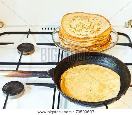 Baked Pancake And Stack Of Prepared Pancakes