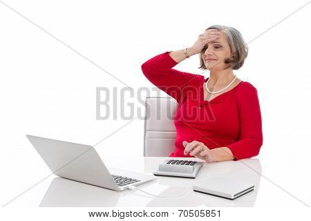 Isolated Portrait Of A Desperate Senior Female Business Woman.