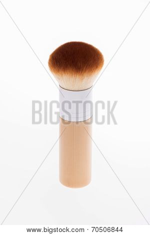 Professional  wooden make-up brush isolated on white background