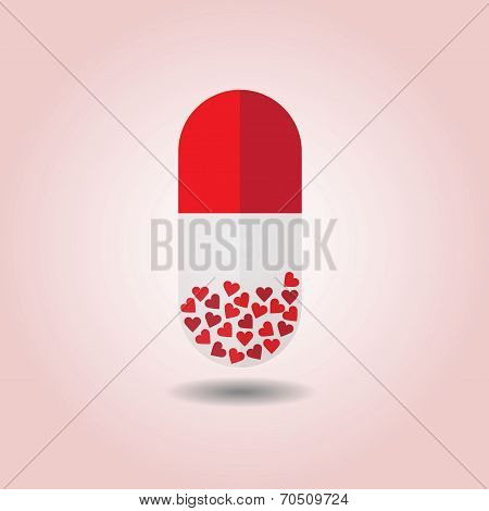 Close up of red vertical capsule on pink background