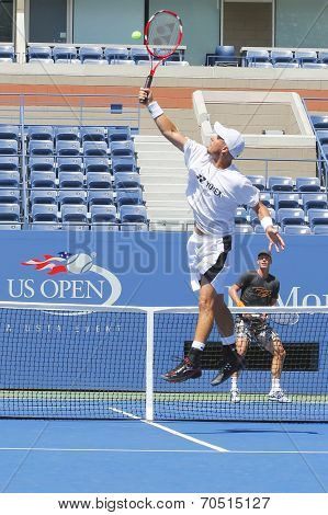 Two times Grand Slam Champion Lleyton Hewitt and tennis player Tomas Berdych practice for US Open