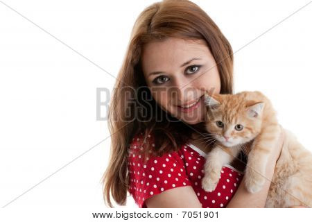 Young Woman With A Kitten.