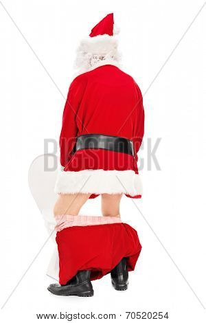 Santa Claus taking a piss in a toilet isolated on white background, rear view