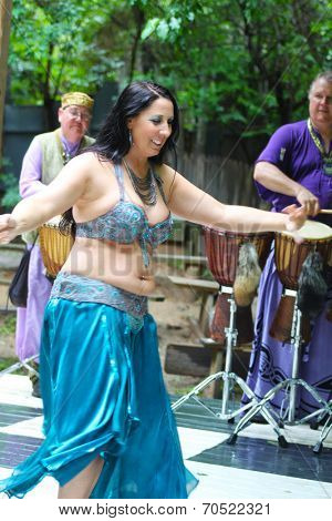 MUSKOGEE, OK - MAY 24: Dancers dressed as Gypsies perform at the Oklahoma 19th annual Renaissance Festival on May 24, 2014 at the Castle of Muskogee in Muskogee, OK.