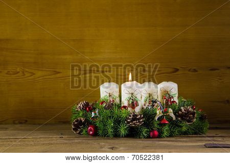 Natural Advent Wreath Or Crown With One Burning White Candle.