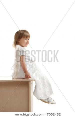 Little Girl Sitting On Pedestal