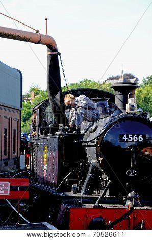 Putting water into steam train, Bridgnorth.