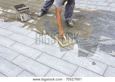 Grouting Tiles On The Floor