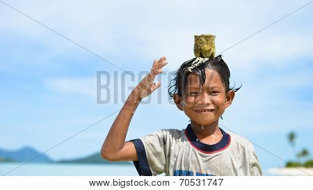 one native child standing in the water, hands up