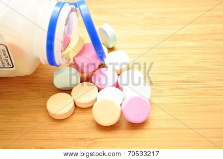 Over The Counter Antacids Falling Out Of The Bottle