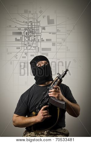 Man With Gun. City Map.
