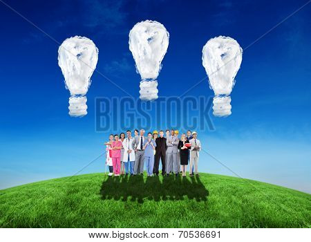 Smiling group of people with different jobs against cloud light bulbs