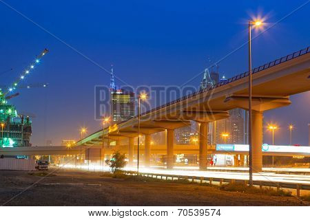 DUBAI, UAE - 3 APRIL 2014: Cars on Sheikh Zayed Road in Dubai on March 30, 2014, UAE. This is the longest highway in the United Arab Emirates and links the two largest cities - Abu Dhabi and Dubai.
