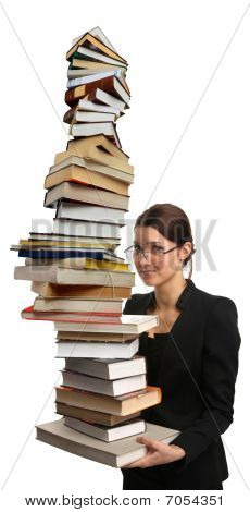 girl holding large pile of books