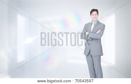 Assertive businessman standing against digitally generated room