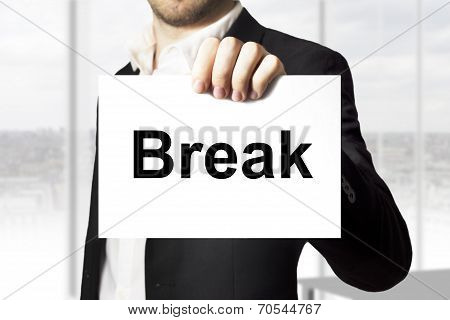 Businessman Holding Sign Break
