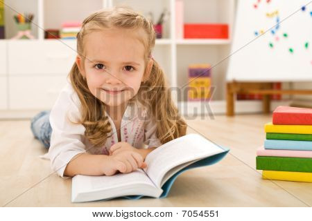 Happy Little Girl Practicing Reading