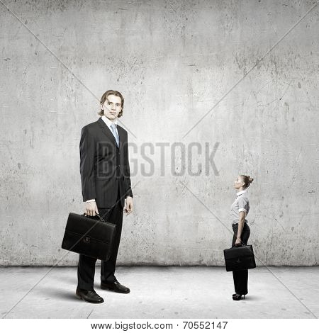 Miniature of young businesswoman and bossy businessman