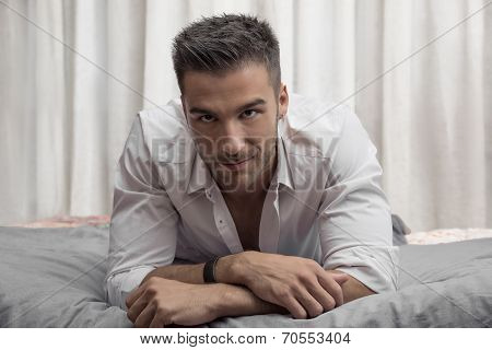 Sexy Male Model Lying Alone On His Bed