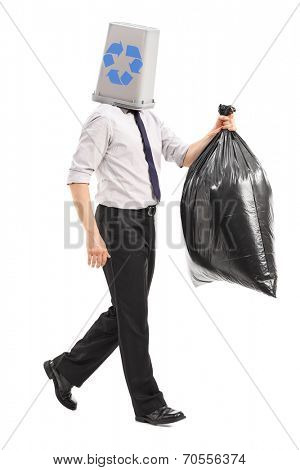 Full length portrait of a man with a recycle bin over his head carrying a garbage bag isolated on white background