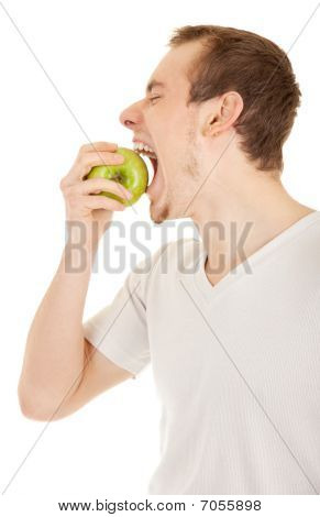 Young Man Bites Green Fresh Apple