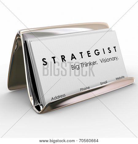 Strategist, Big Thinker and Visionary words on a business card stack in a holder as your tool to attract business to your consulting, marketing or planning firm