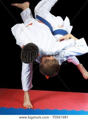 Beautiful high throw are doing  sportsmen in judogi