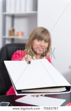Woman Is Handing Over A File