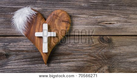 Wooden Background With Olive Heart And White Cross For An Obituary Notice.
