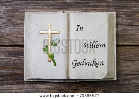 Mourning: Cross And German Text On A Book Of Stone.