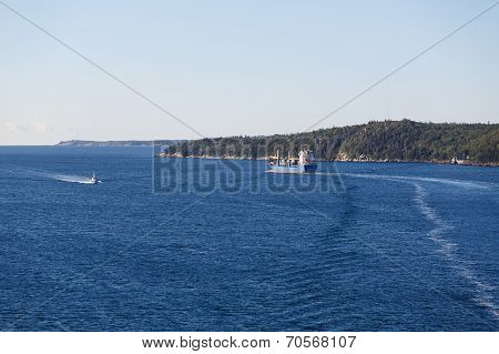 Freighter Heading Up Coast Of Canada In Blue Water