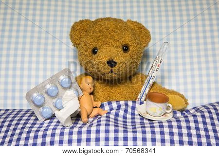 Sick Teddy Bear Lying in Bed
