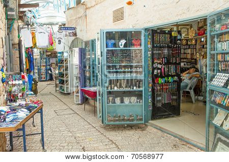 Tourists walk by shops and art galleries in Safed's old city alleys