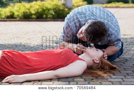 Man Checking If Woman's Conscious