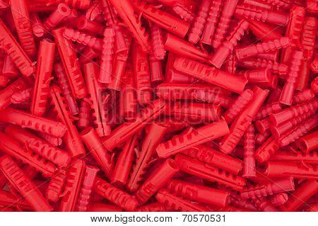 Red plastic dowels.