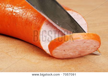 Cutting Slice Of Kielbasa
