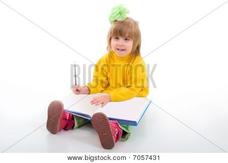 Cute Little Schoolgirl Sitting With A Books. Studio Shoot Over White Background.