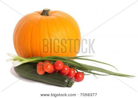 Pumpkin, Courgette And Tomatoes On The White Background