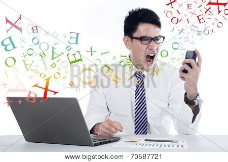 Young Businessman Shouting At Mobilephone