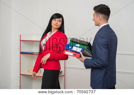 Business couple flirting in office