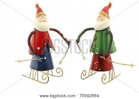 Old vintage metal Santa Claus figures on a sleigh usable for christmas greeting cards