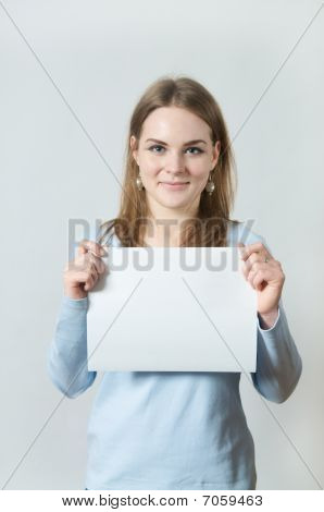 Young Woman Showing Blank Piece Of Paper
