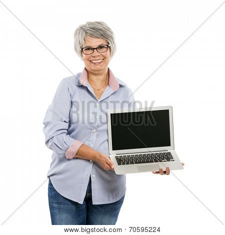 Happy elderly woman holding and showing something on a laptop